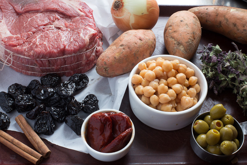 ingredients for chipotle pot roast of beef, beef roast, sweet potatoes, prunes, cinnamon, chickpeas, olives, chipotle peppers
