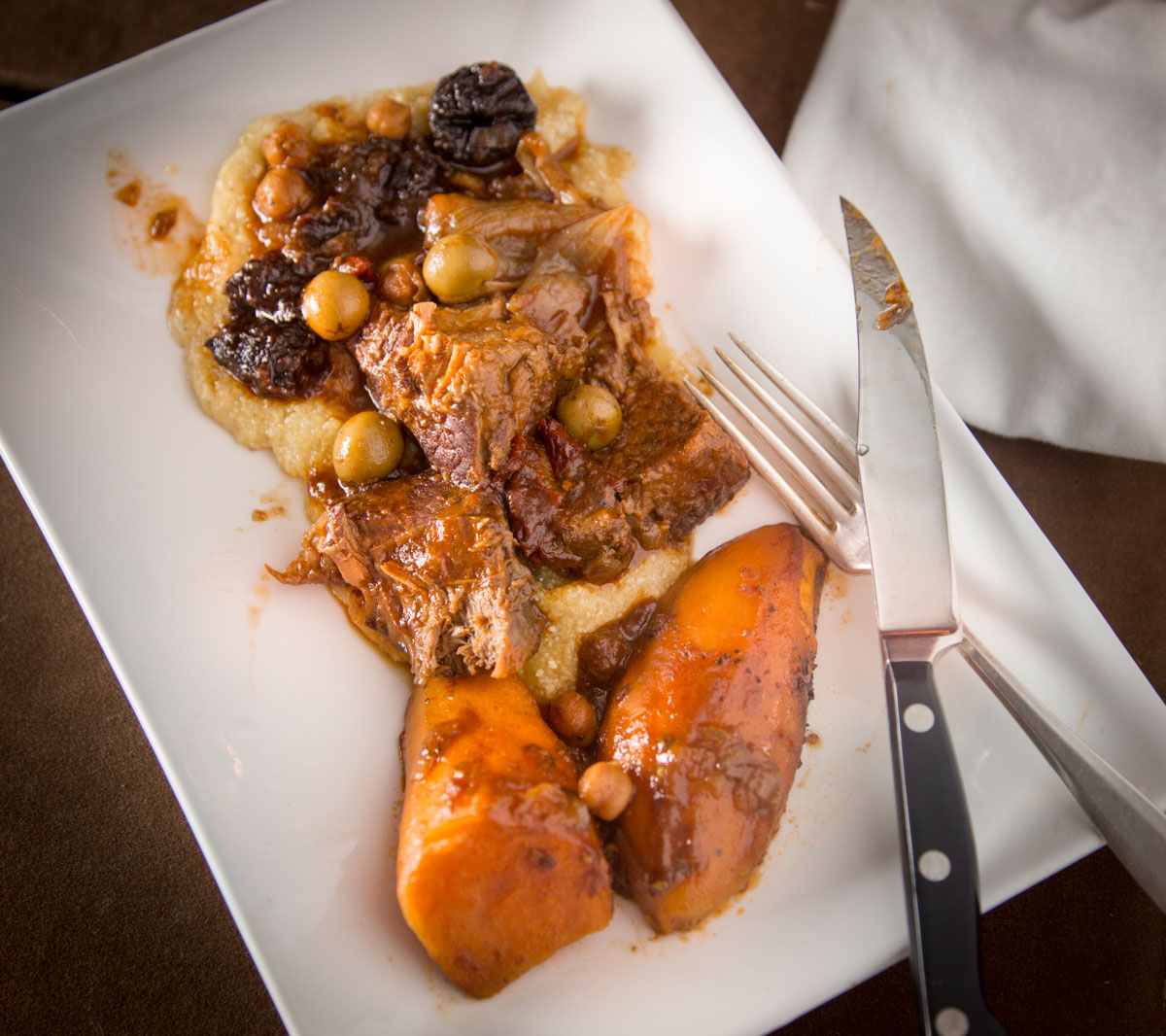 a serving of chipotle pot roast with prunes, olives, chickpeas, and sweet potatoes