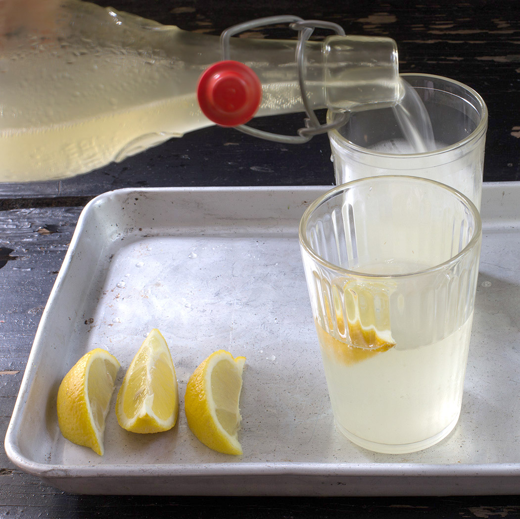 elderflower champagne being poured into a glass