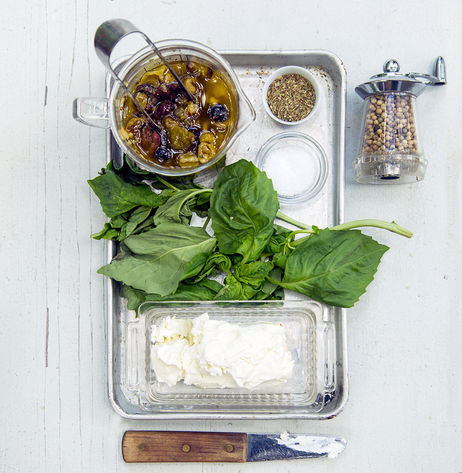 ingredients for a pressed picnic sandwich, basil, goat cheese, tapenade
