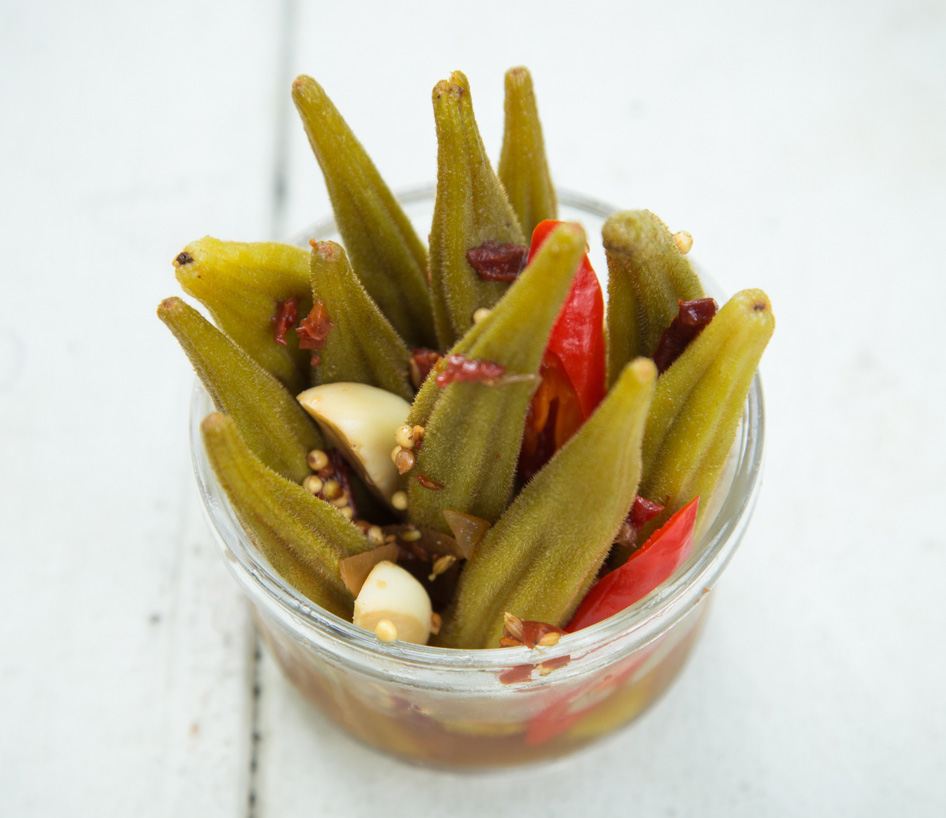 Chipotle pickled okra standing in a jar